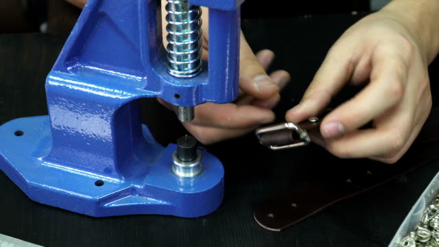 Put rivets on a leather belt video