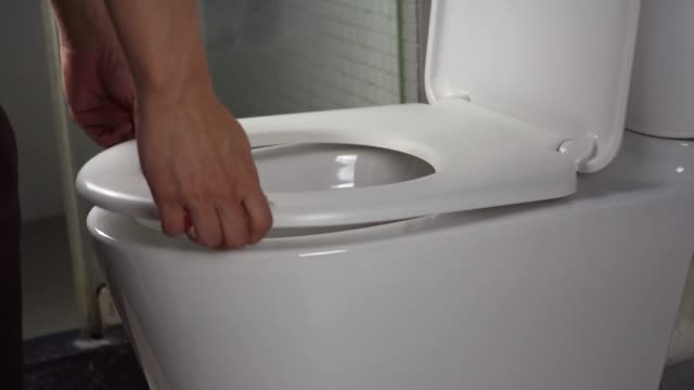 Put toilet lip up before using Put toilet lip up before using seat stock videos & royalty-free footage