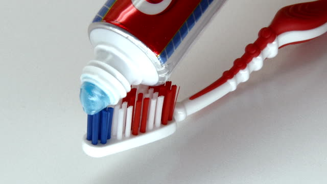 Put toothpaste on toothbrush video