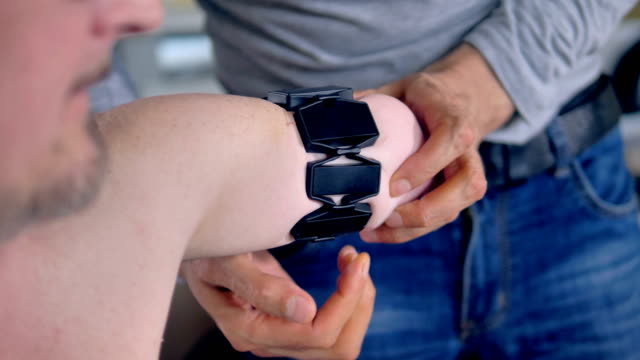 Putting bionic bracelet on the amputated arm. video