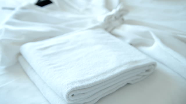 Putting fresh towel on bed video