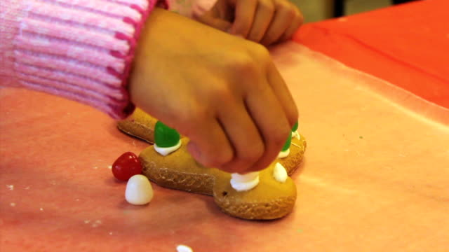 Putting Gum Drops On Christmas Gingerbread Man Cookie video