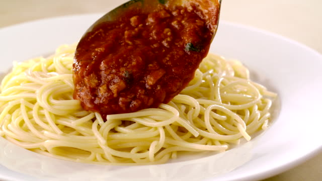 Putting meat sauce on spaghetti, Slow Motion video