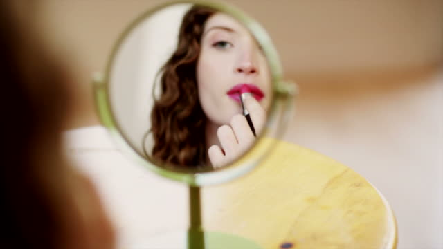 Putting on Lipstick  red lipstick stock videos & royalty-free footage
