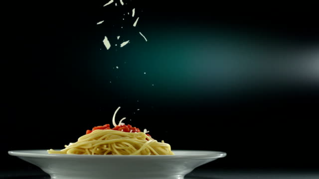 putting parmesan cheese on spaghetti, slow motion - fine dining stock videos and b-roll footage