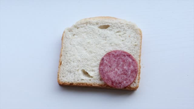 putting peaces of salami on white bread video