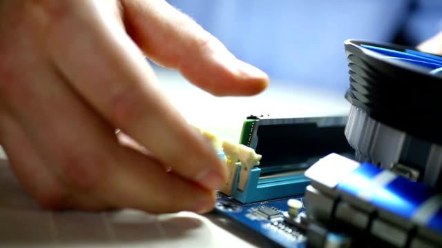 Putting RAM memory chip into laptop. video