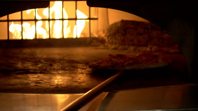 putting the pizza in the burning oven - pizza stock videos and b-roll footage