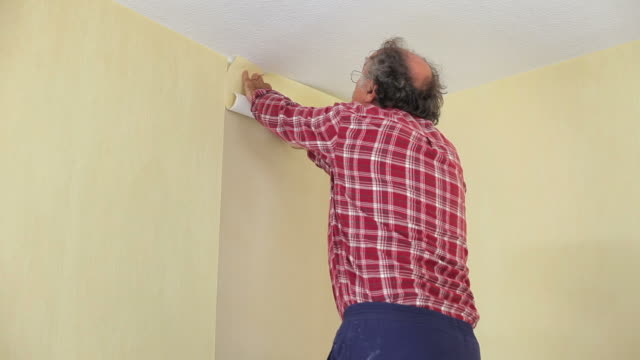 Putting up wallpaper video