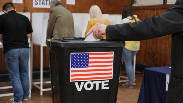 4K DOLLY: Putting Vote in Ballot Box at the USA Election - Voting at Polling Station
