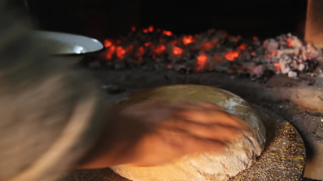 HD: Putting Yeast Dough In Brick Oven video