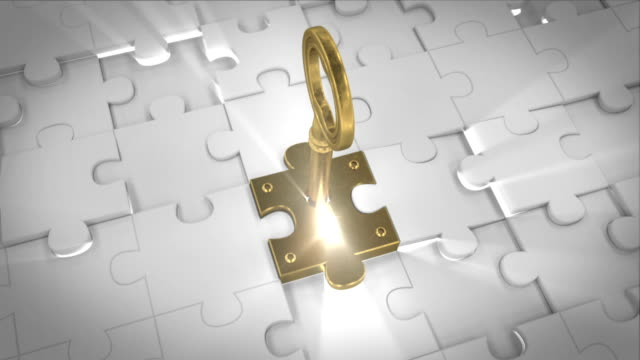 Puzzle Key A Key in a puzzle piece. keyhole stock videos & royalty-free footage