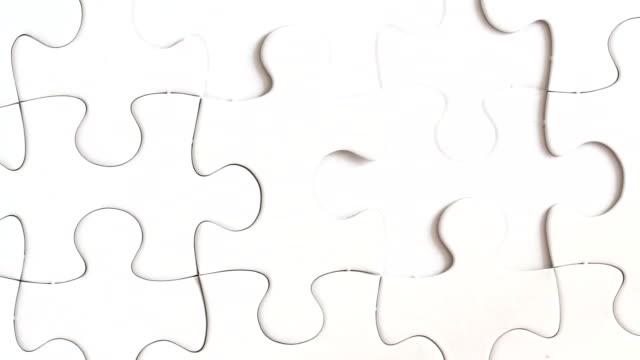 stockvideo's en b-roll-footage met puzzle - legpuzzel