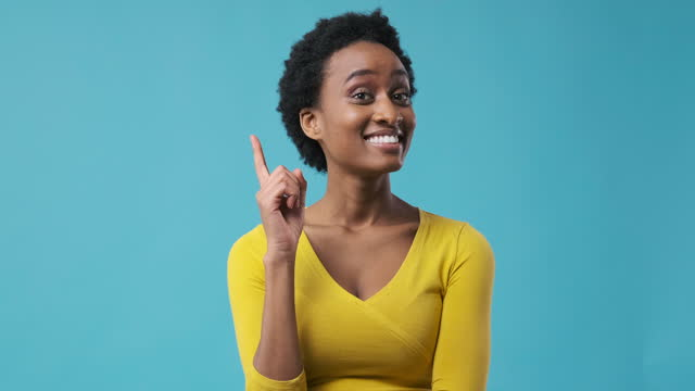 Puzzled woman coming up with a good idea Puzzled african american woman coming up with a good idea gesturing stock videos & royalty-free footage