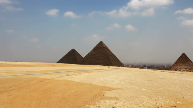 Pyramids on the background of Cairo. Approximation video