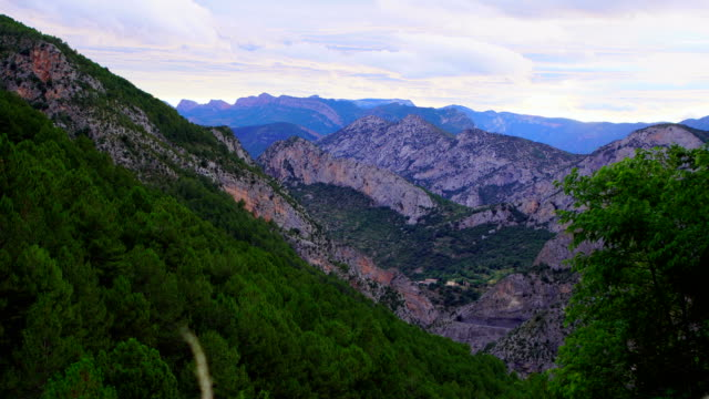 Pyrenees video - Clouds running fast in summer Clouds over Coll de Nargó's mountains running fast in sunset. Catalonia. lleida stock videos & royalty-free footage