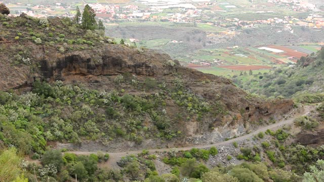 quad bike riding on dirt road path in gran canaria mountains - supercross video stock e b–roll