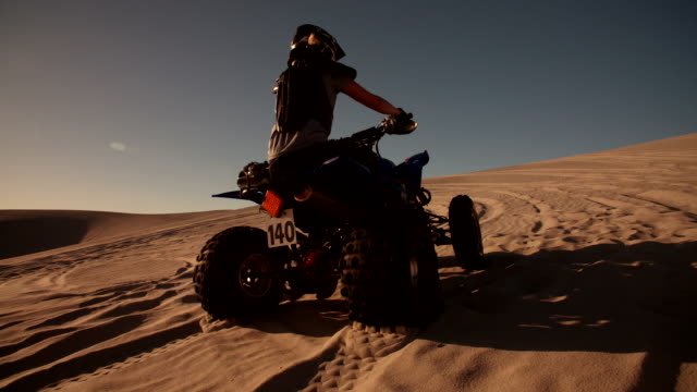 Quad bike with excellent tyre tread going uphill
