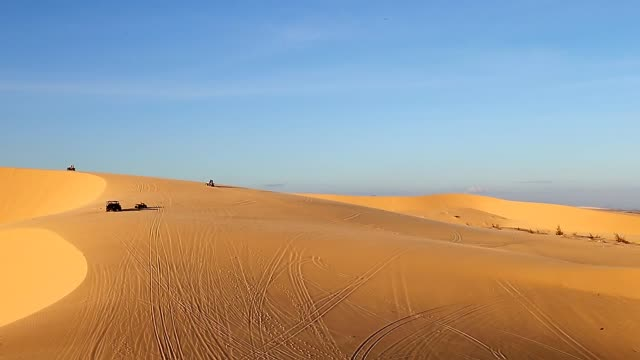 ATV quadbike safari racing sand dune.