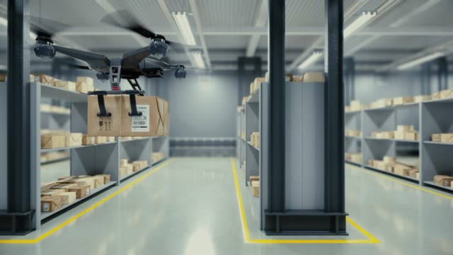 quadcopter delivers a package from the warehouse. - telecomando background video stock e b–roll