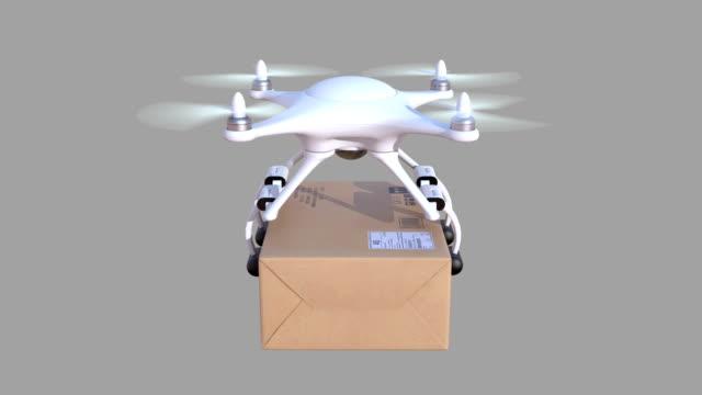vídeos de stock, filmes e b-roll de quadcopter oferece um pacote - multicóptero