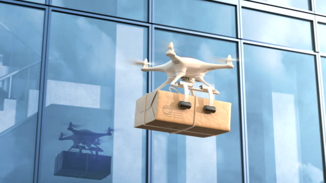 quadcopter delivers mail against an office building - quadcopter filmów i materiałów b-roll