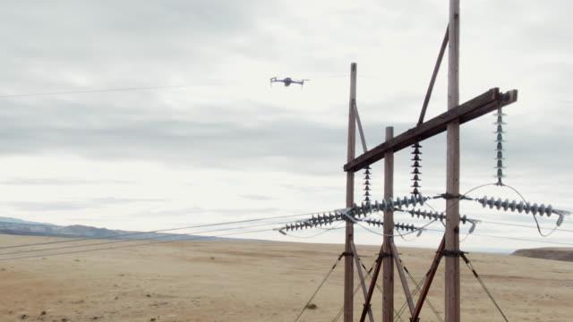 A Quadcopter Drone Inspects Power Lines in the Grand Valley of Western Colorado under a Partly Cloudy Sky