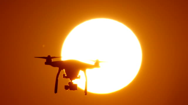 HD - Quadcopter drone on background of the Sun video