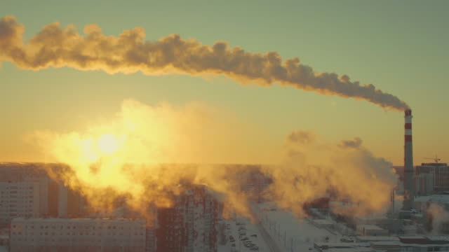 Quadcopter filmed how a huge thermal power plant harms the beautiful snowy city.