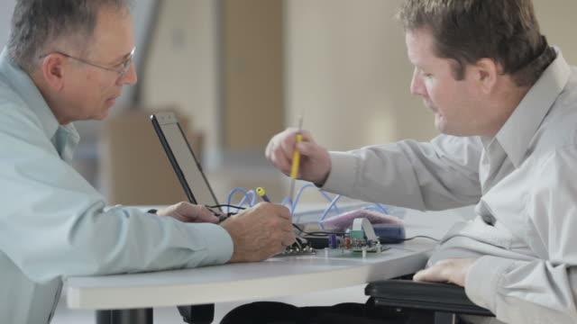 Quadriplegic Engineer in Design Review Meeting