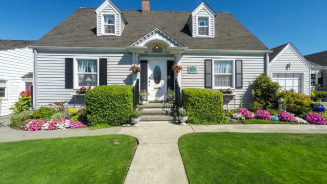Quaint American Suburban Home Exterior 4k clip of a quaint, small American suburban home exterior; departing dolly shot front door stock videos & royalty-free footage