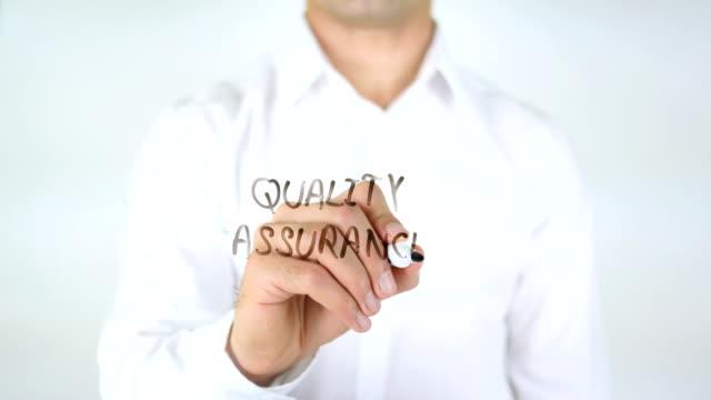 Quality Assurance, Man Writing on Glass video