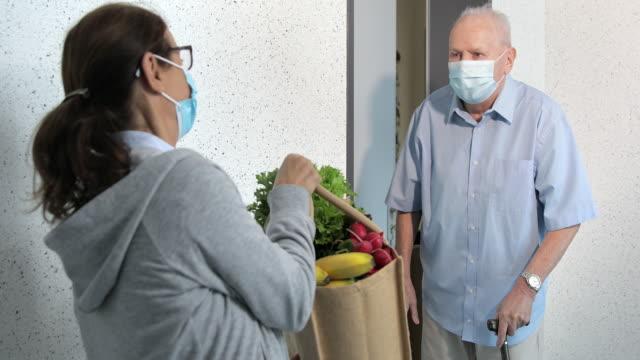 Quarantine – woman helping senior man