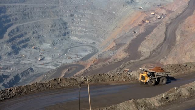 Quarry with ore. Works appliances. Excavators and BelAZ. In the frame, BelAZ passes, filled with ore. Quarry with ore. Works appliances. Excavators and BelAZ. In the frame, BelAZ passes, filled with ore.Slo construction vehicle stock videos & royalty-free footage