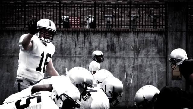 Quarterback throws football. video