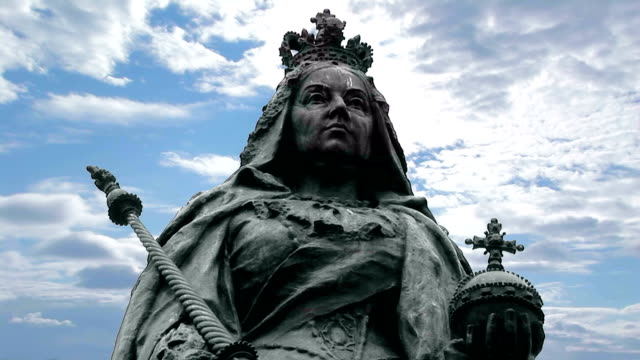 Queen Victoria statue Bronze Statue of Queen Victoria with cloudy blue skies Hull Yorkshire, UK european culture stock videos & royalty-free footage