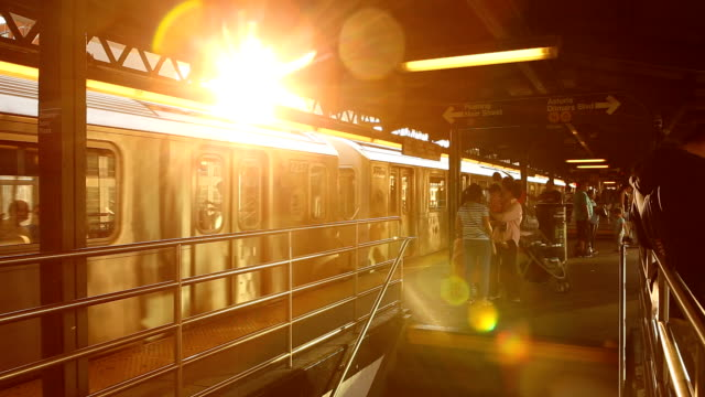 Queensboro Plaza Subway Sunset in New York City Sunset at Queensboro Plaza subway station in New York City. subway platform stock videos & royalty-free footage