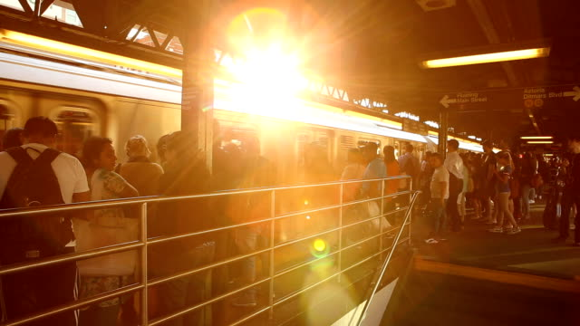 Queensboro Plaza Sunset at subway station in Queens, New York City. subway platform stock videos & royalty-free footage