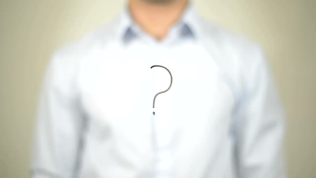 Question Mark Sign, man writing on transparent screen video