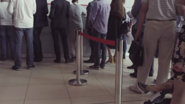 Queue of people waiting in line to be served. The queue of people standing in the cash. Could be a post office, bank or ticket sales agent Queue of people waiting in line to be served. The queue of people standing in the cash. Could be a post office, bank or ticket sales agent. post office stock videos & royalty-free footage