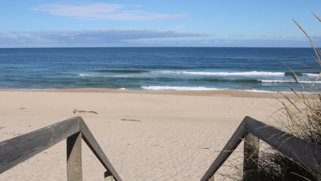 Quiaios beach, sand and ocean waves seen from the boardwalk
