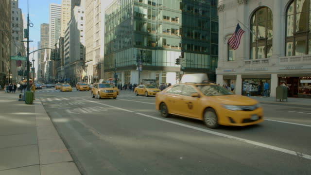 Quick zoom out New York City fifth avenue Traffic video