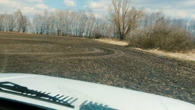 Quickly ride an off-road vehicle on a freshly plowed field, view through the windshield. Agricultural land, POV video video