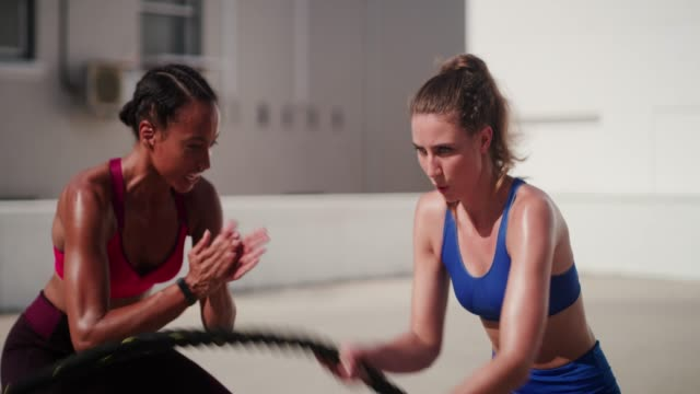 Quitting is never an option for her 4k video footage of a young sportswoman being encouraged by her personal trainer while working out outdoors sportsperson stock videos & royalty-free footage