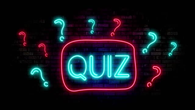 quiz neon light on brick wall - competizione video stock e b–roll