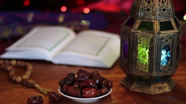 koranen, datum, rosenkransen och orientalisk lykta lampa - ramadan lykta bildbanksvideor och videomaterial från bakom kulisserna