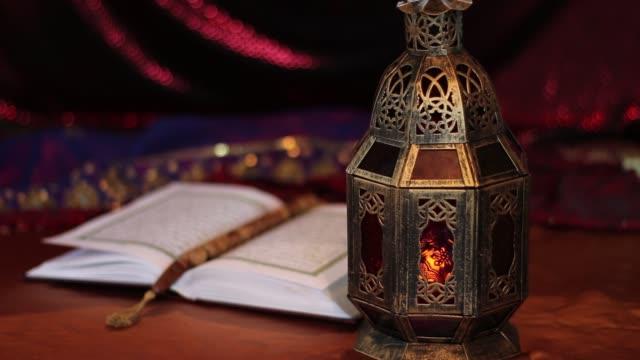 stockvideo's en b-roll-footage met quran, datums, rozenkrans en oosterse lantaarn lamp - koran