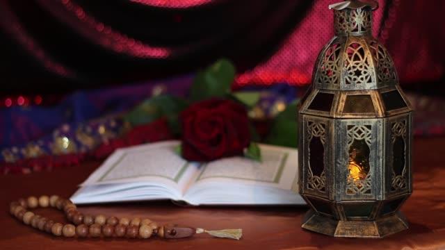 kur'an, fener ve gül - kurban bayramı stok videoları ve detay görüntü çekimi