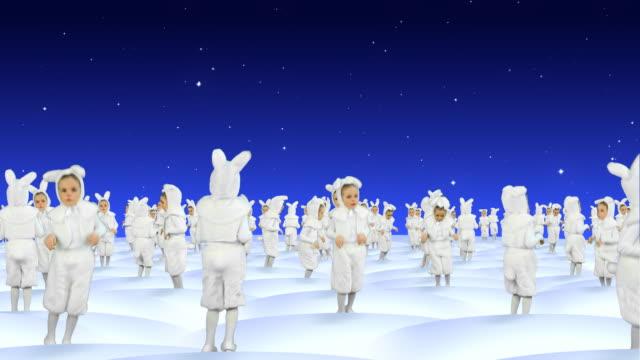 rabbits dancing at snowfield celebrating christmas - tavşan hayvan stok videoları ve detay görüntü çekimi