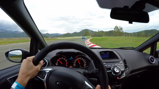 Race car drivers point of view on a race track video